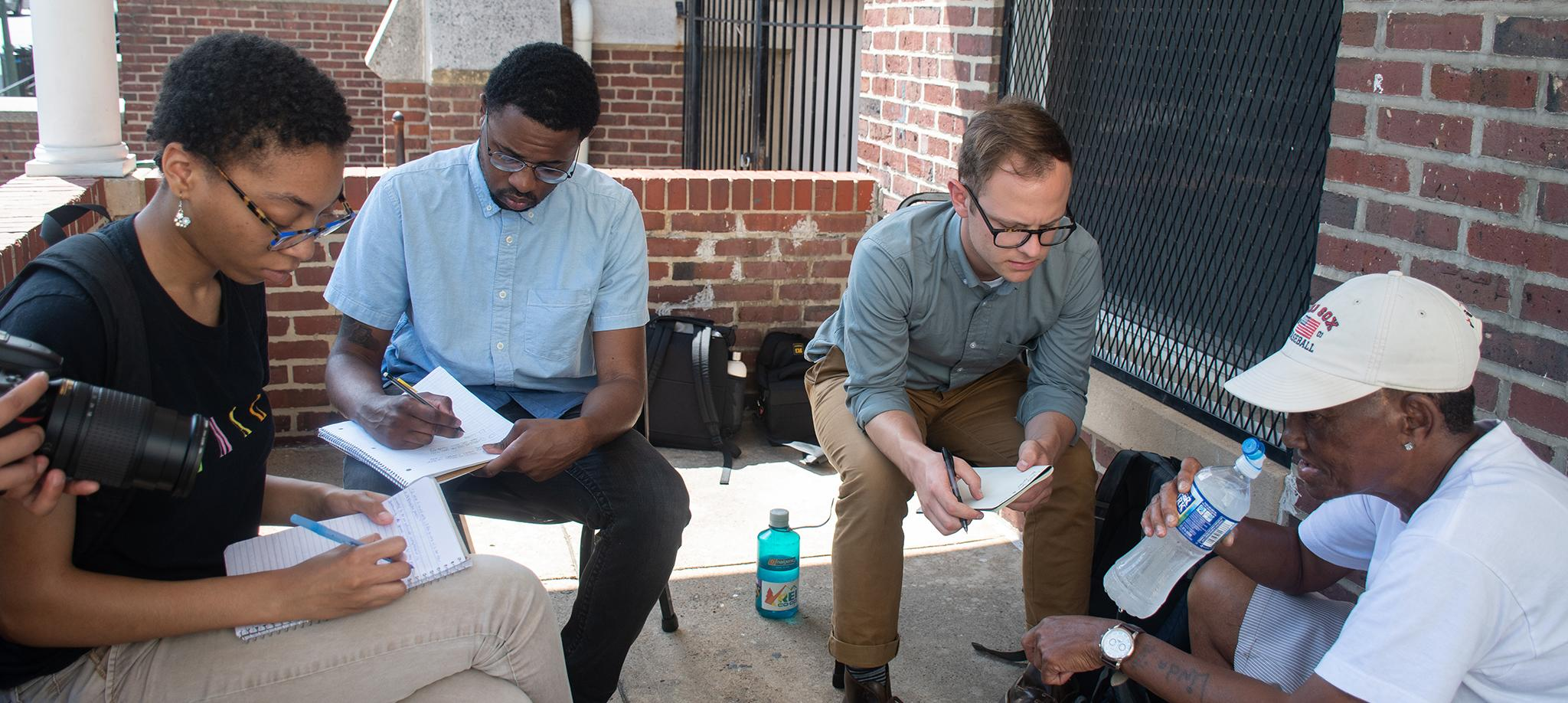 Howard Center students conducting interviews in Baltimore.